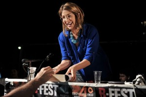 Canadian author and social activist Naomi Klein signs a copy of her book after addressing the Athens anti-authoriterian festival late on May 25, 2013. The fourth edition of international anti-authoritarian festival B-Fest takes place at Panepistimioupoli, the Athens University Campus. Klein has attracted a considerable following in Greece, where the Greek translation of her book The Shock Doctrine was in the bestsellers list for months. AFP PHOTO/ LOUISA GOULIAMAKI