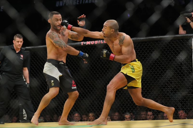 LAS VEGAS, NV - JULY 9: Jose Aldo punches Frankie Edgar during the UFC 200 event at T-Mobile Arena on July 9, 2016 in Las Vegas, Nevada. Rey Del Rio/Getty Images/AFP== FOR NEWSPAPERS, INTERNET, TELCOS & TELEVISION USE ONLY ==