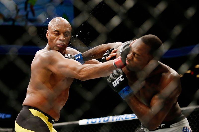 NEW YORK, NY - FEBRUARY 11: Derek Brunson (R) of United States lands a punch against Anderson Silva (L) of Brazil in their middleweight bout during UFC 208 at the Barclays Center on February 11, 2017 in the Brooklyn Borough of New York City. Anthony Geathers/Getty Images/AFP== FOR NEWSPAPERS, INTERNET, TELCOS & TELEVISION USE ONLY ==