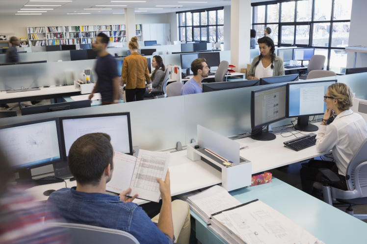 Business people working in open office