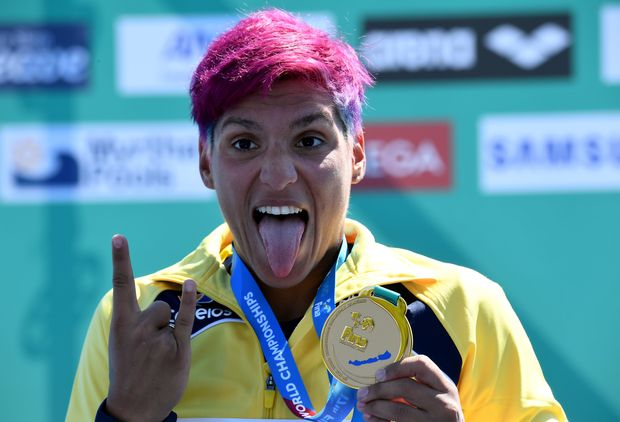 Gold medalist Brazil's Ana Marcela Cunha celebrates her victory on the podium after the women's 25 km open water swimming event at the 2017 FINA World Championships in Balatonfured on July 21, 2017